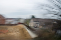 18mm Lens, ISO 100, 1/4 Secs, F22 Attempted to pan with the house on a moving train